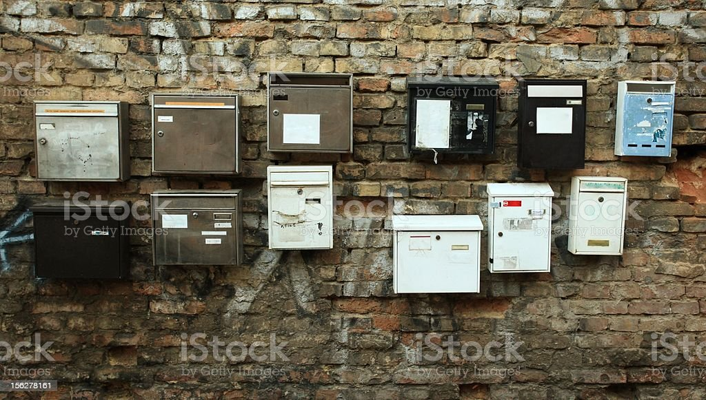 Mail boxes on wall with graffiti stock photo