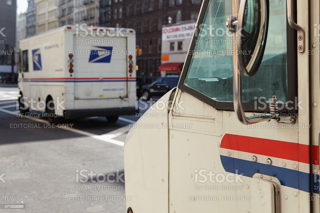 USPS mail delivery vans trucks NYC stock photo
