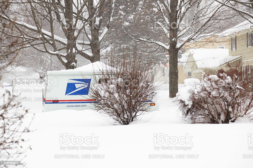 US Mail Postal Service Delivery Truck in Winter Blizzard stock photo