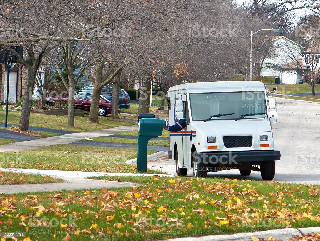 mail truck in the suburbs stock photo