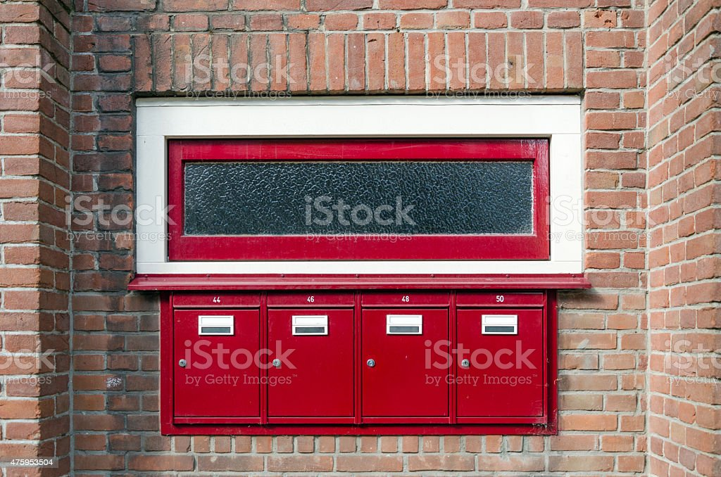 Mailbox and window outside apartment building stock photo