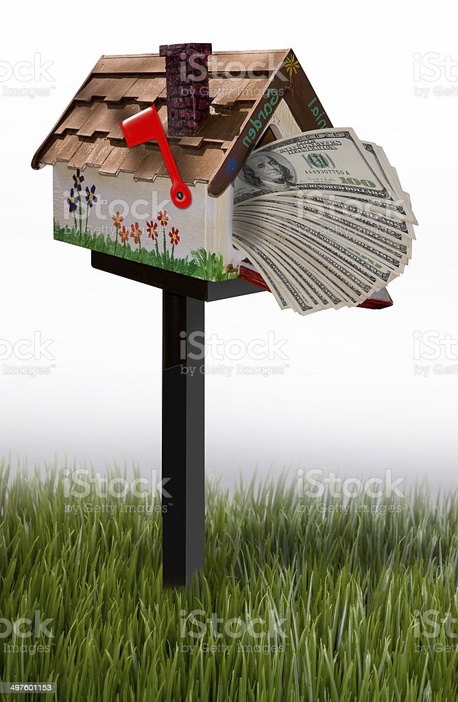 Mailbox full of money. stock photo
