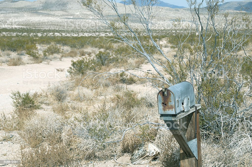 Mailbox on dirt road in California desert stock photo
