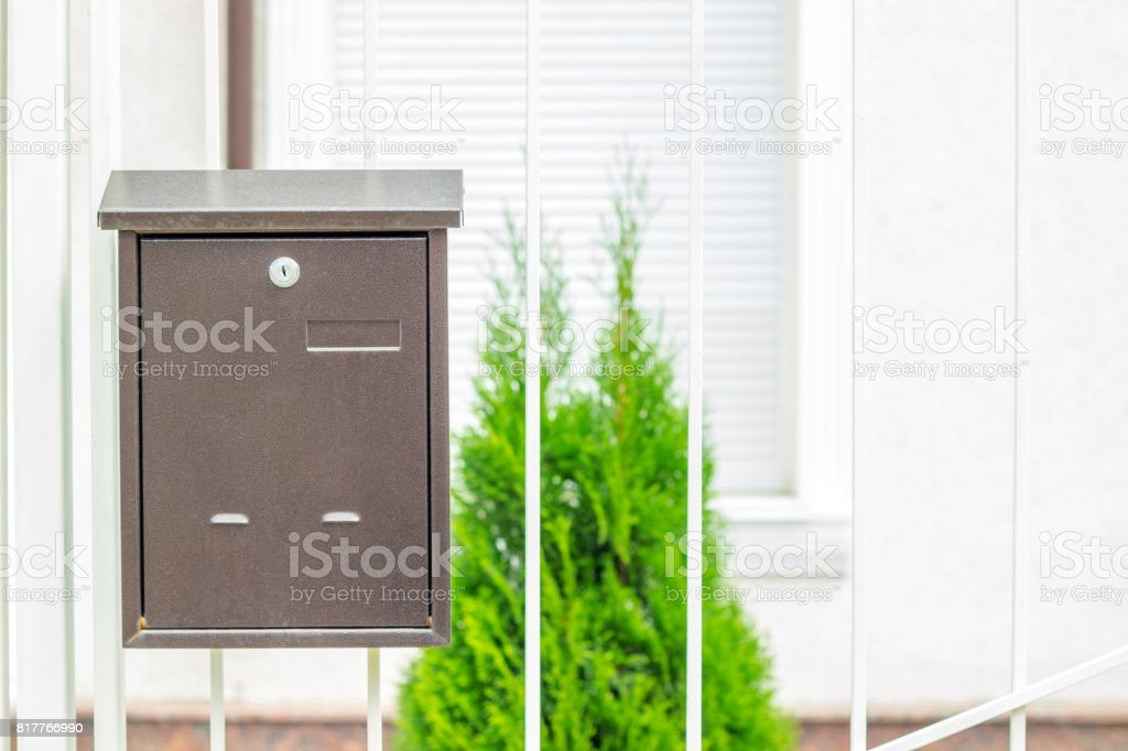 Mailbox on old classic iron doors. Traditional metal letterbox stock photo