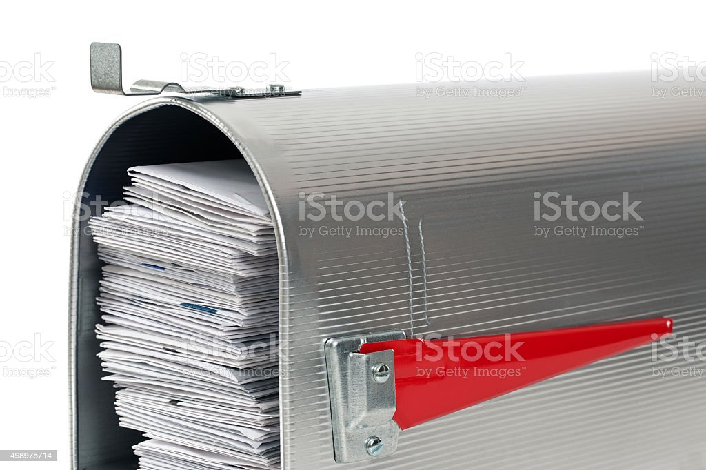 Mailbox Very Full of Mail stock photo