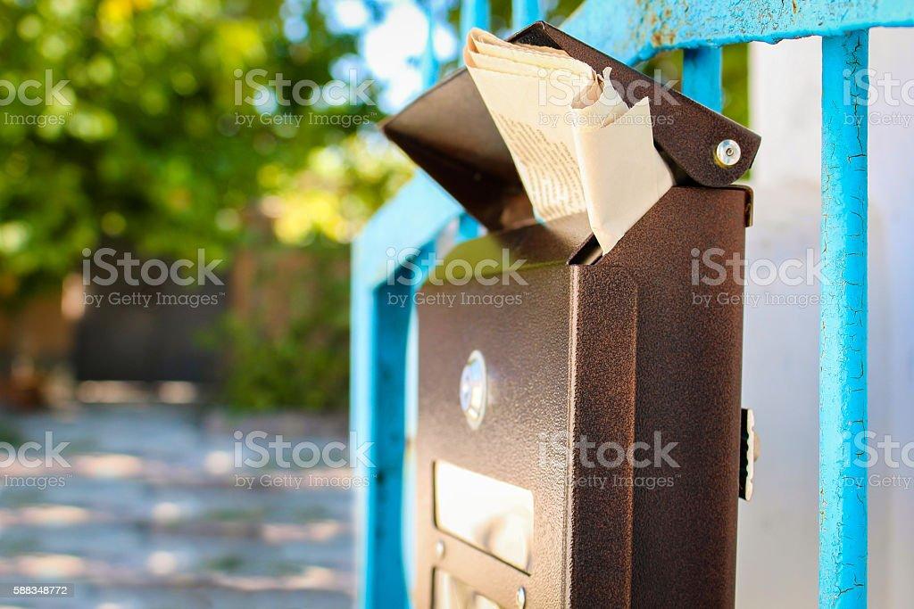 Mailbox with newspaper stock photo