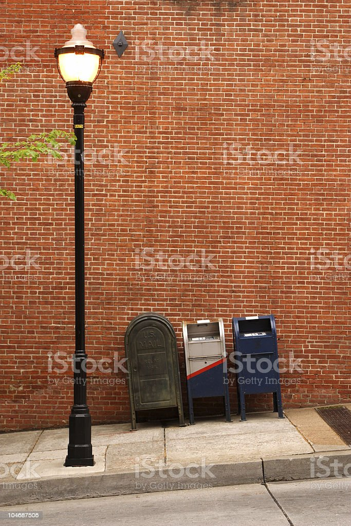 mailboxes and streetlight stock photo