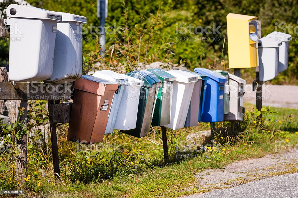 Mailboxes in a row on the Swedish countryside stock photo