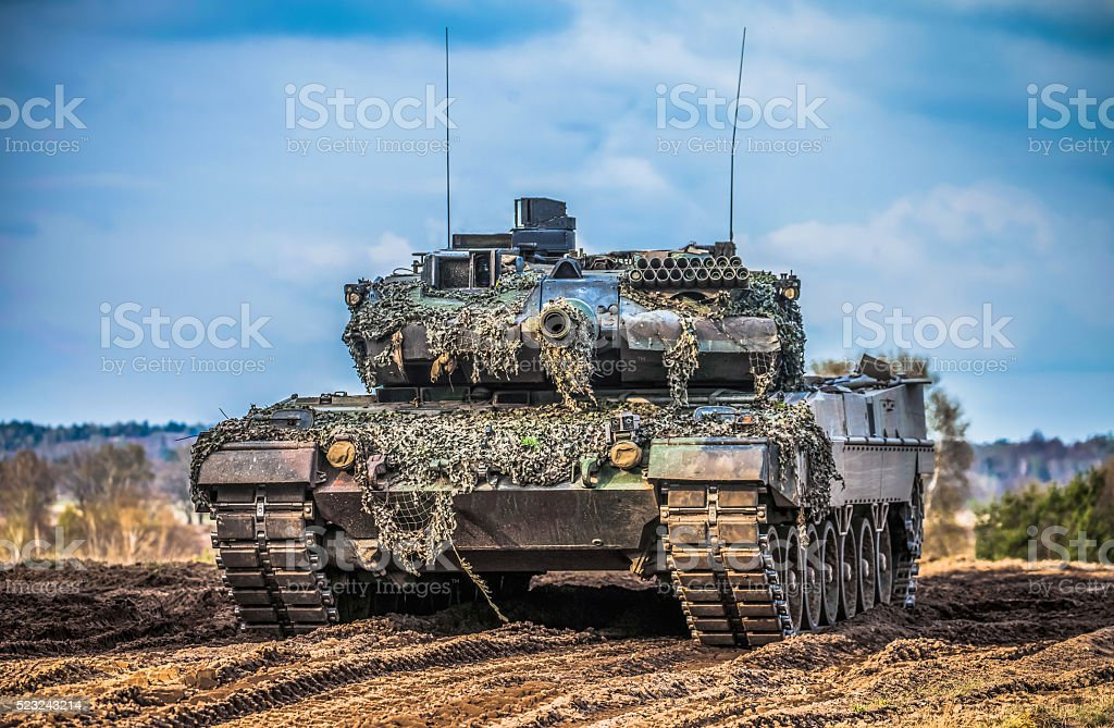 main battle tank stands in position to shoot stock photo