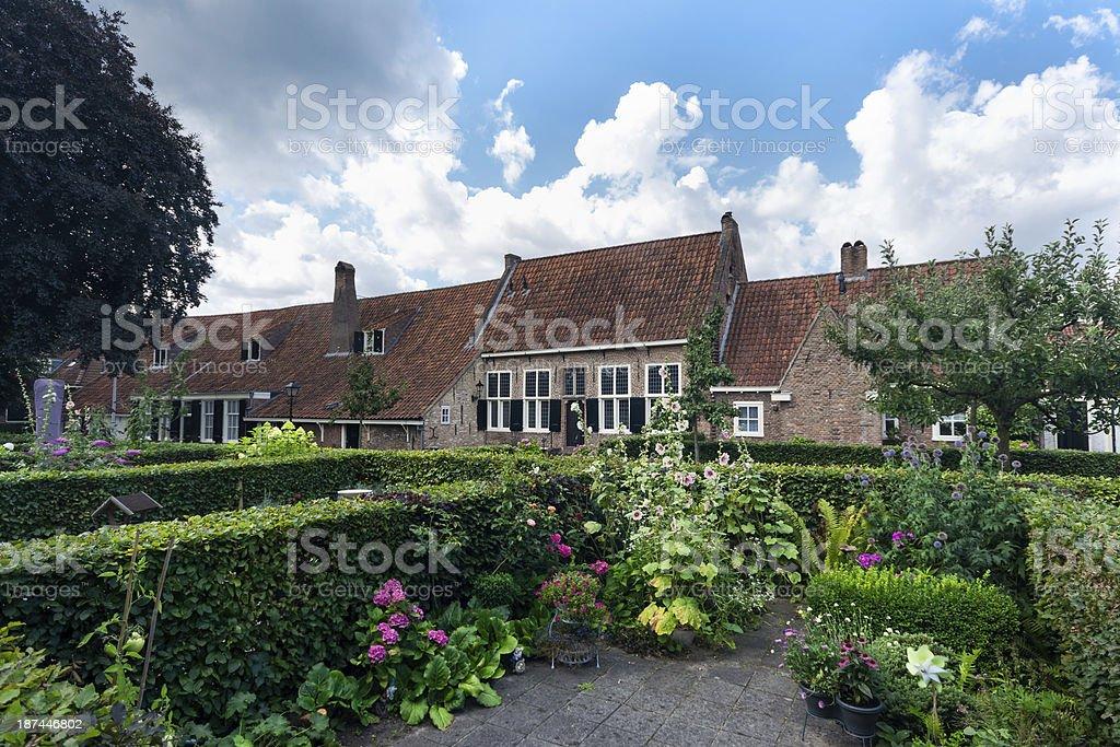 Main Building behind hedges Hofje Armen de Poth stock photo