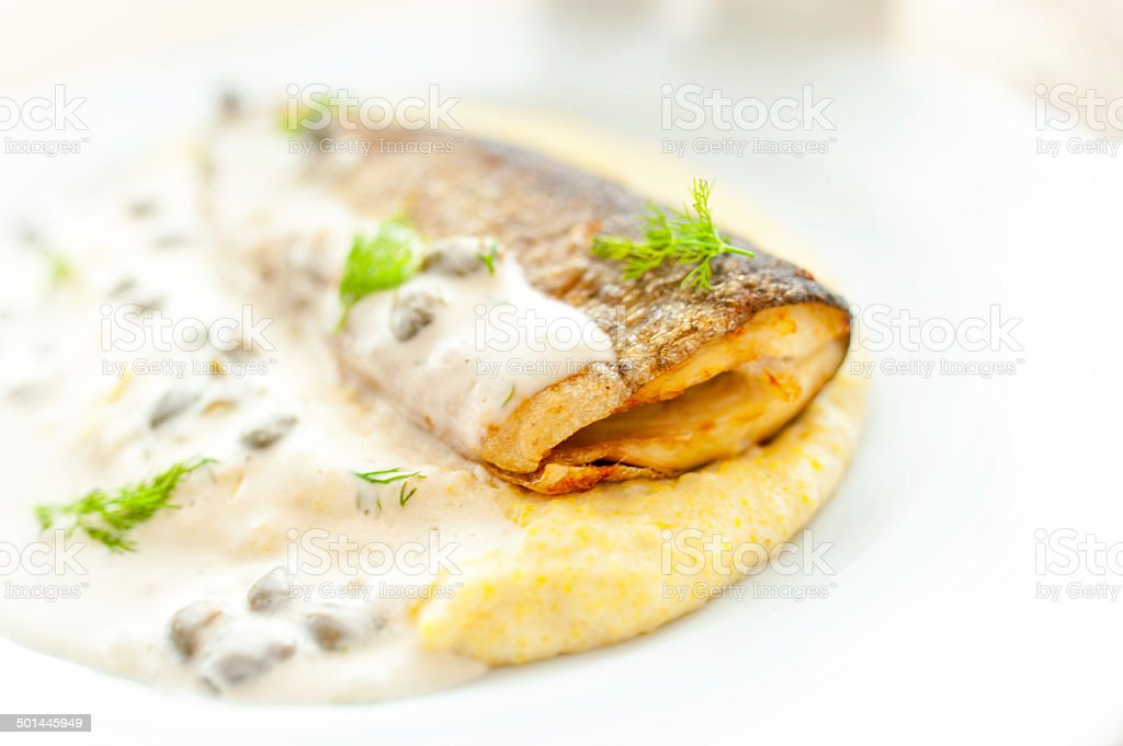 main course - mashed potatoes with fish and white sauce stock photo