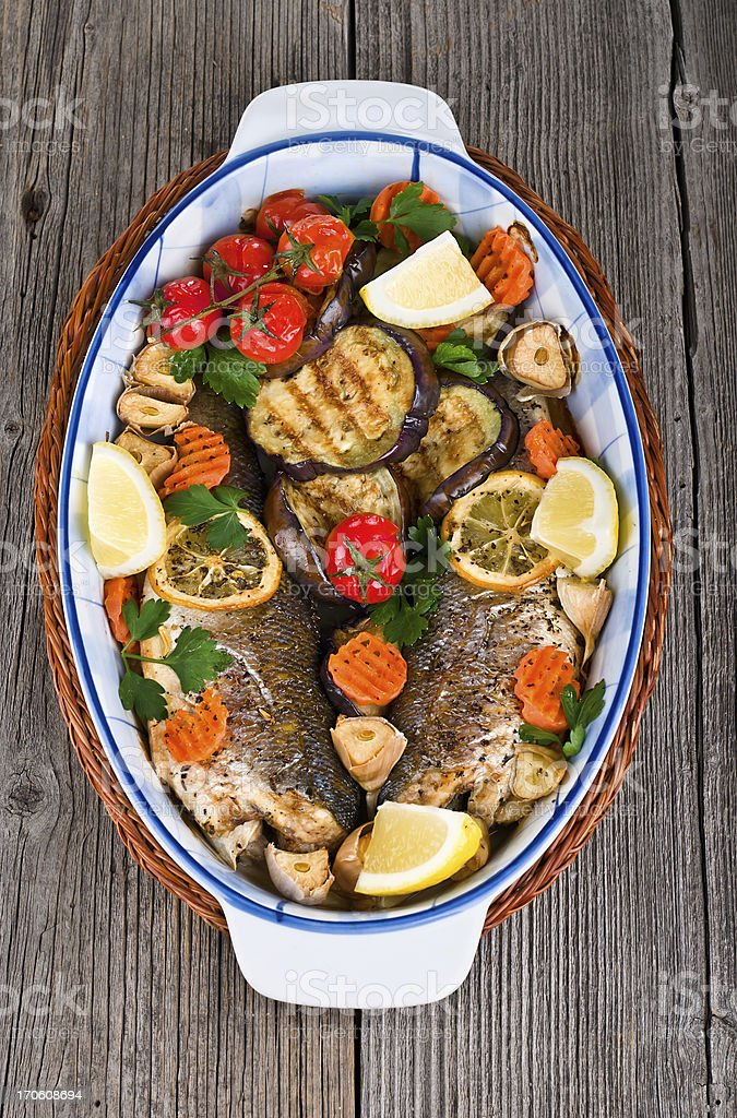 main course: whole fried seabass served on wood royalty-free stock photo