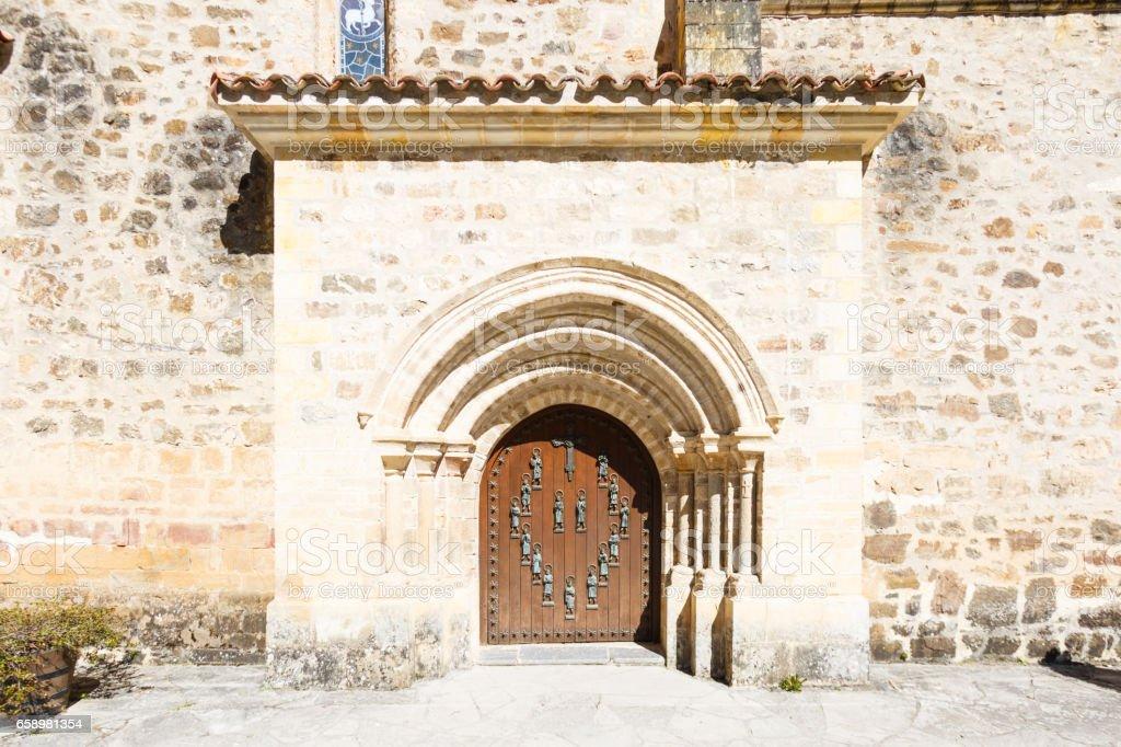 Main door of the Santo Toribio de Liebana monastery, Potes, Cantabria, Spain stock photo