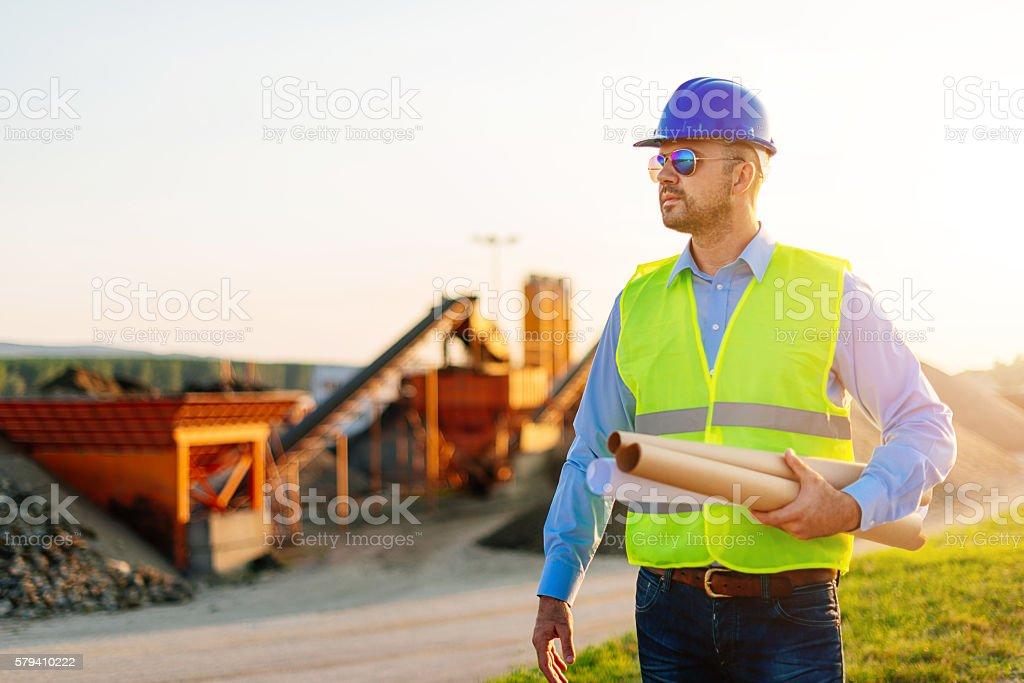 Main engineer with blueprints stock photo
