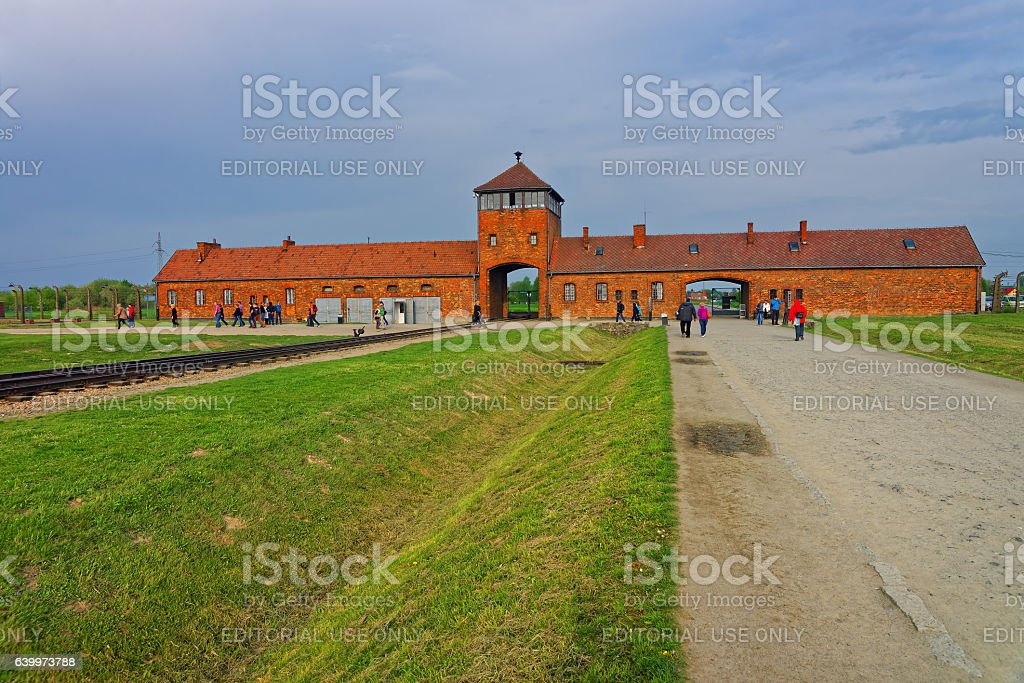 Main entrance gate into concentration camp in Auschwitz Birkenau stock photo