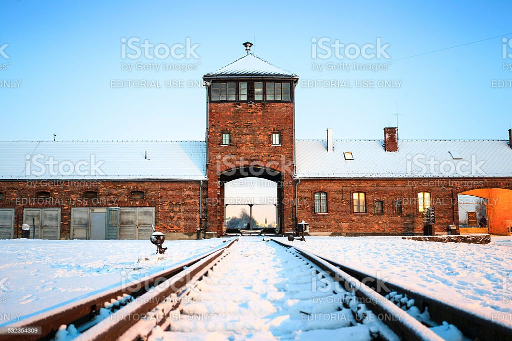Main gate to nazi concentration camp of Auschwitz Birkenau. stock photo