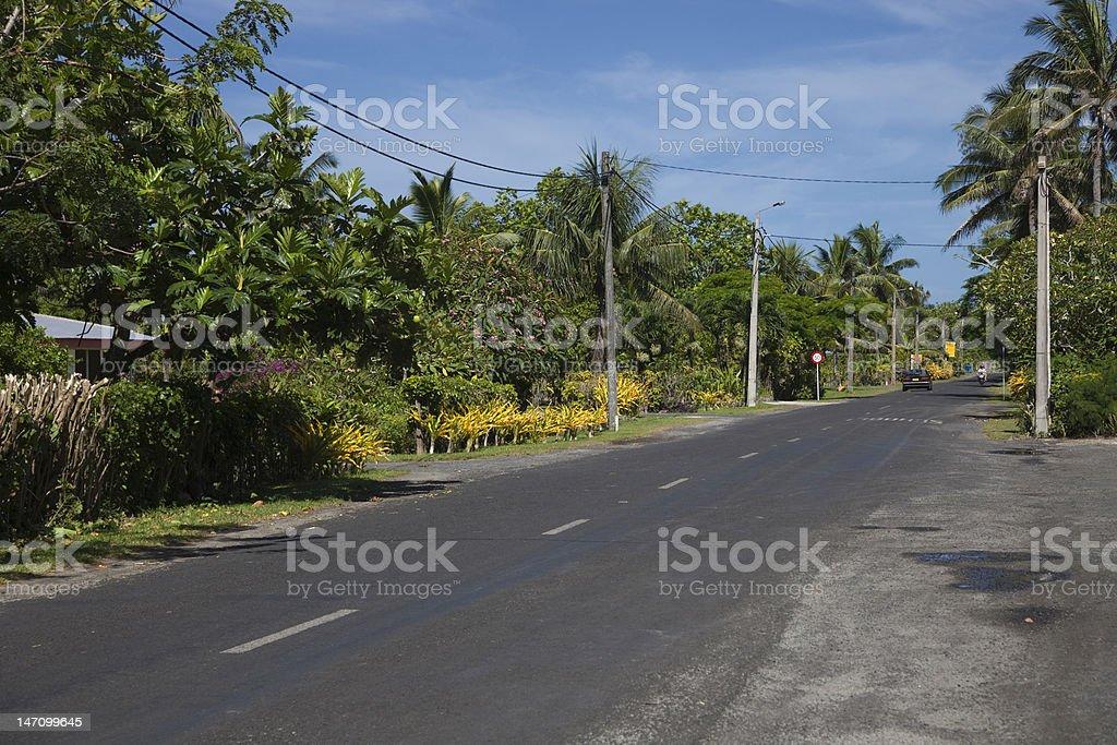 Main Road Ara Tapu on Cook Islands stock photo