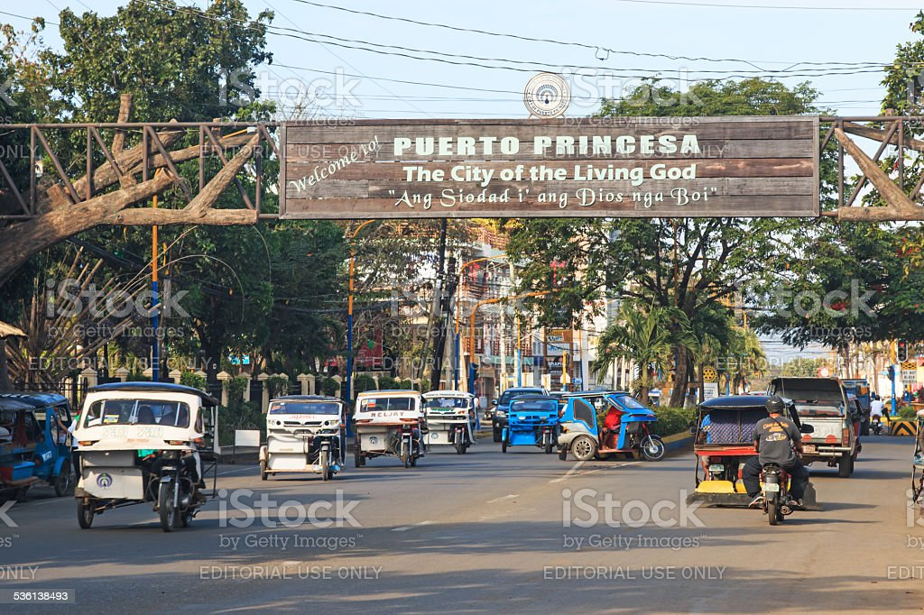 Main road of Puerto Princesa with many tricycles stock photo