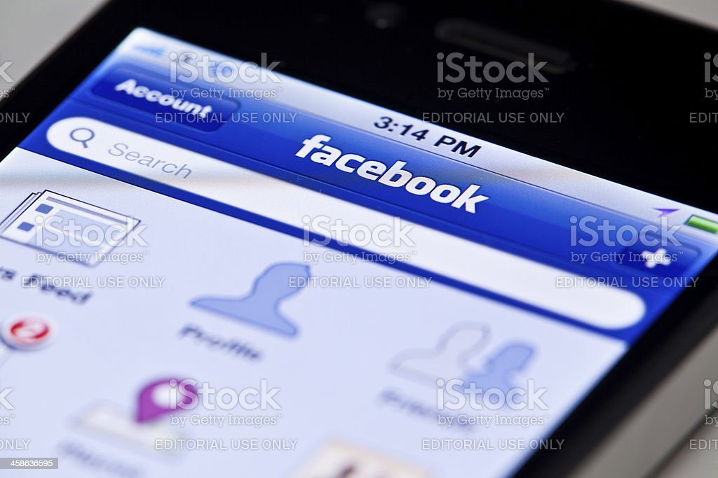 Main screen of Facebook app on iPhone 4 royalty-free stock photo