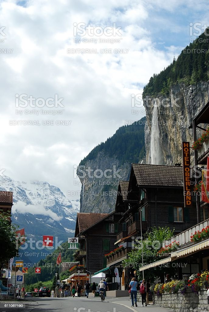 Main street in Lauterbrunnen, with Staubbach Falls in the background. stock photo