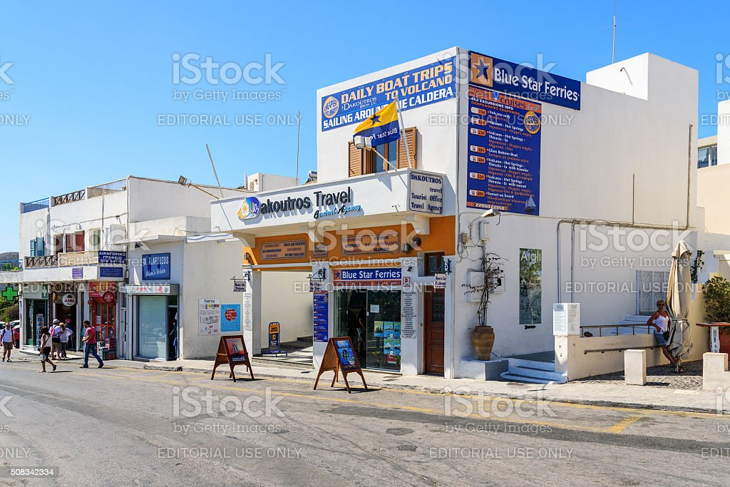 Main street of Thira town with office of Travel agencies stock photo