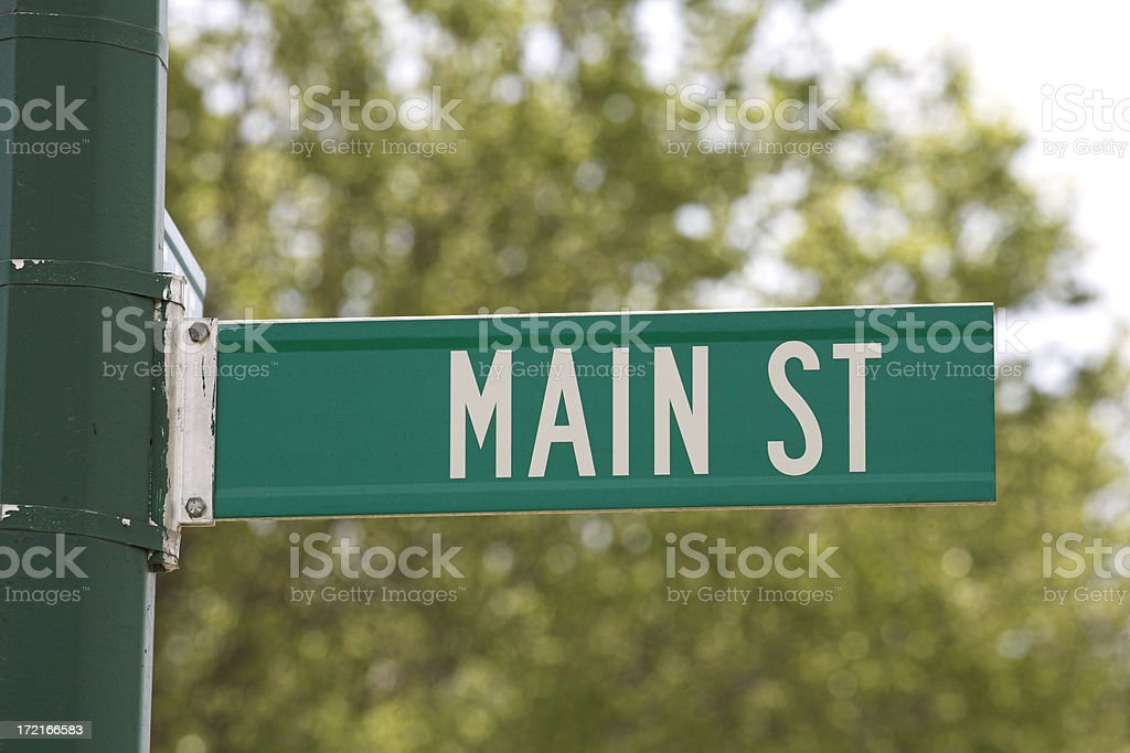 Main Street Sign on Green Pole stock photo
