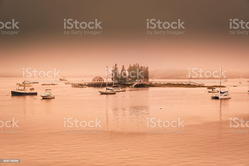 Maine harbor with dawn glow and fog stock photo