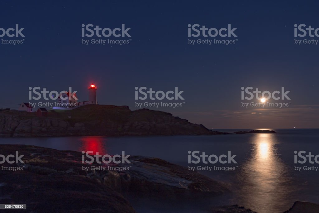 maine light house with a full moon stock photo