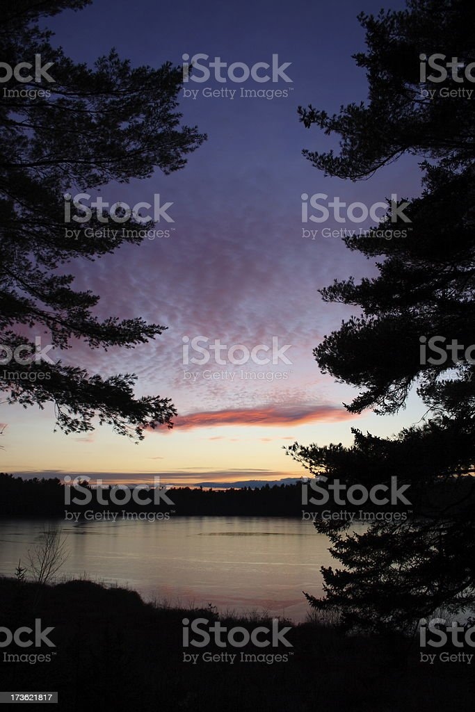 Maine Sunset Over Frozen Pond stock photo