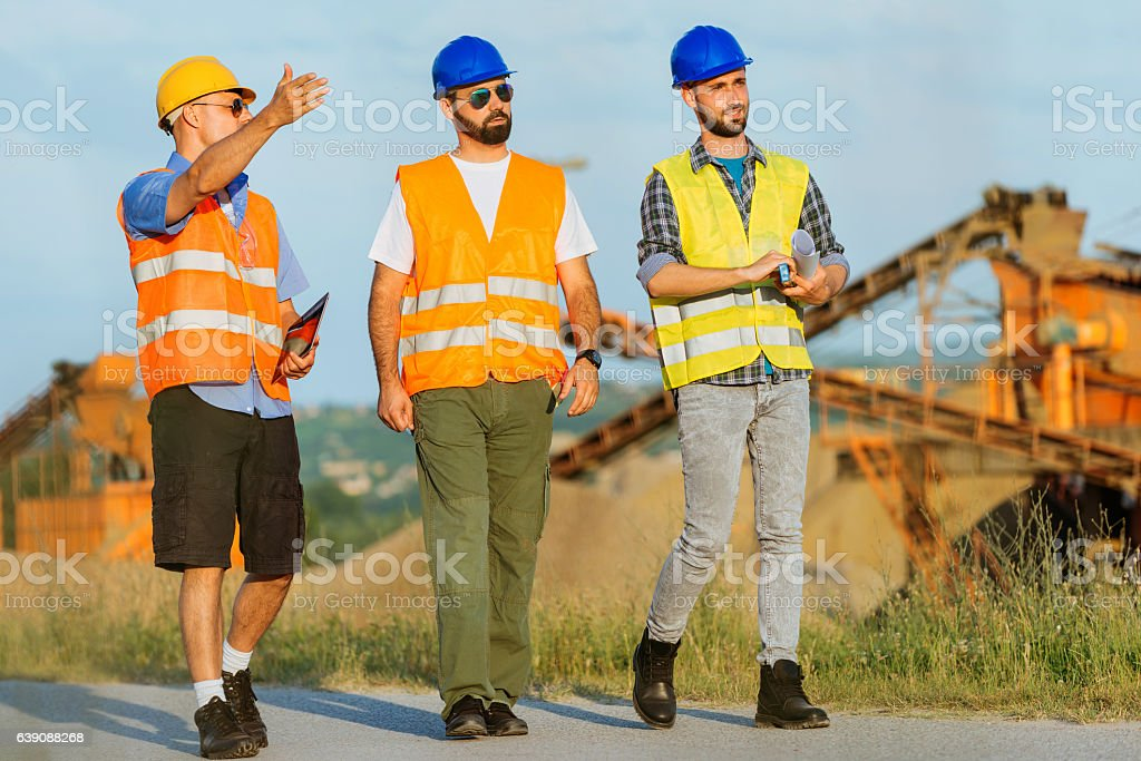 Maintain consturction machinery on construction site stock photo