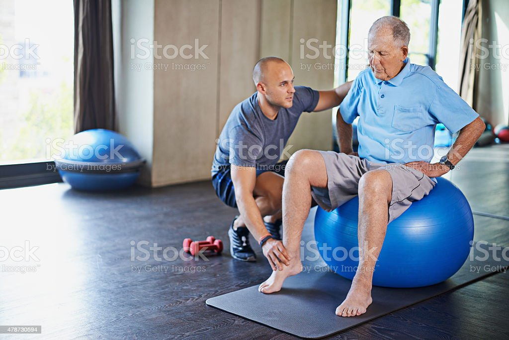 Maintaining his muscles through physiotherapy stock photo