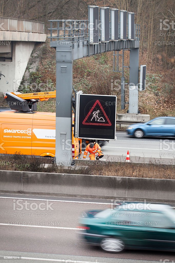 Maintenance and service work on a variable-message signs stock photo