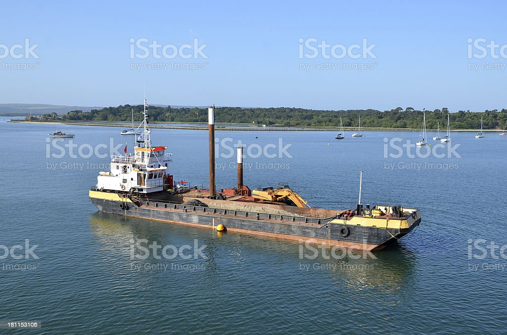 Maintenance Boat at Work in Poole Harbour stock photo