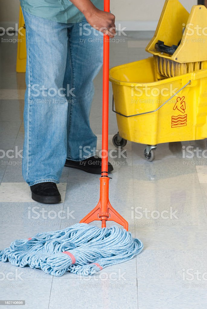 Maintenance man cleaning office floor royalty-free stock photo