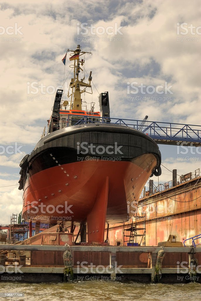 Maintenance of a ship at the dock stock photo