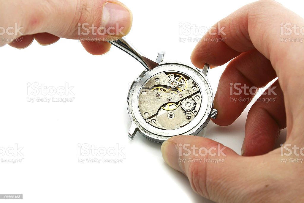Maintenance of clockwork stock photo