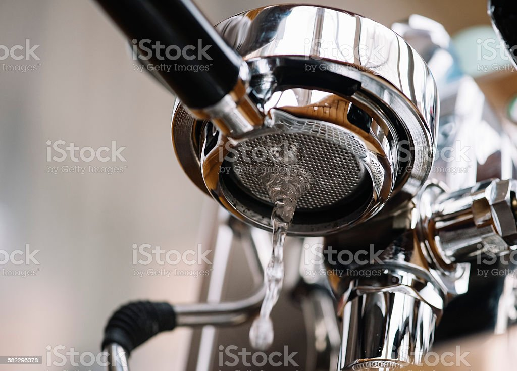Maintenance of the espresso machine's group: basic water cleaning stock photo