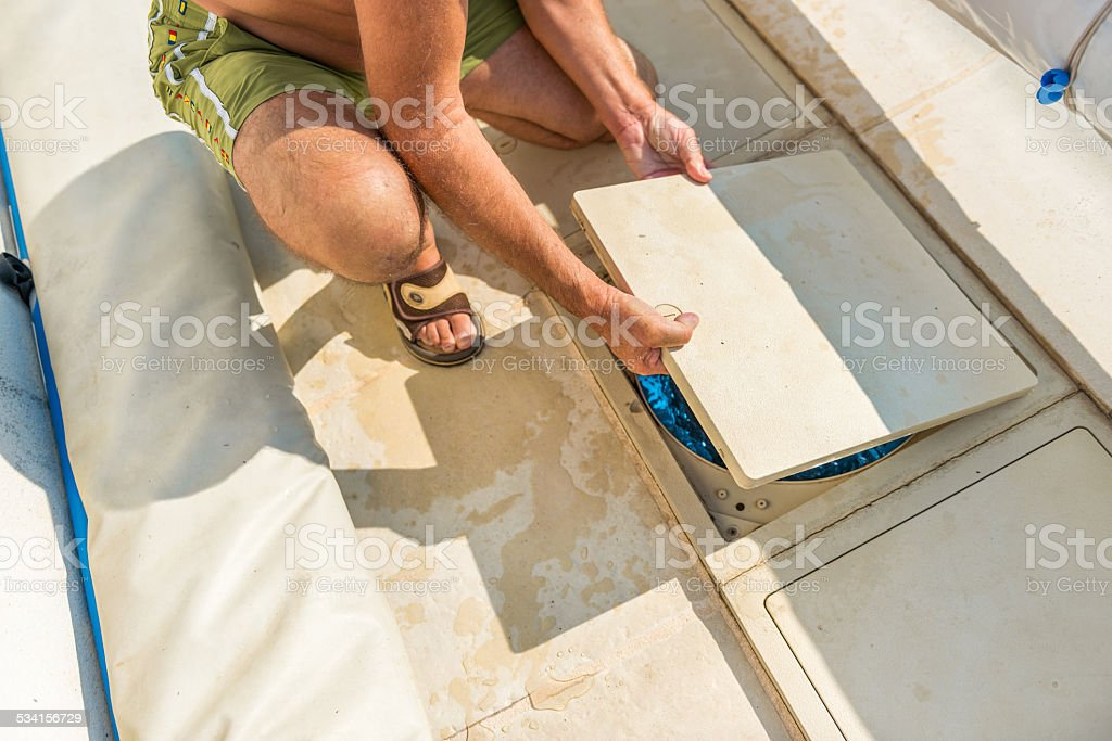 Maintenance of the pumping system of a pool royalty-free stock photo