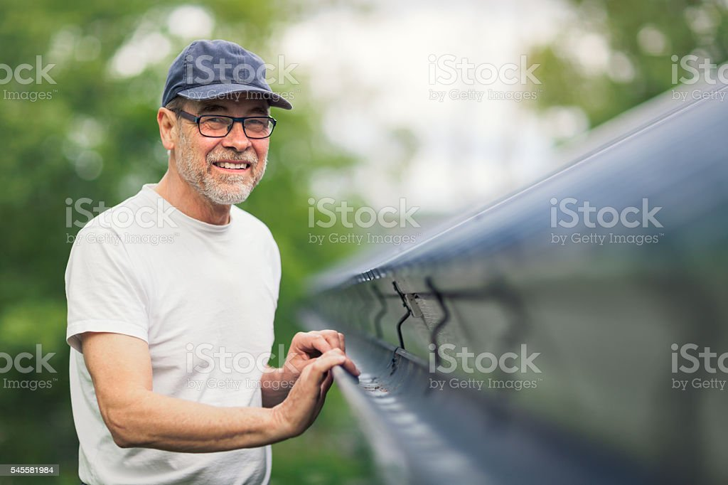 Maintenance on the roof stock photo