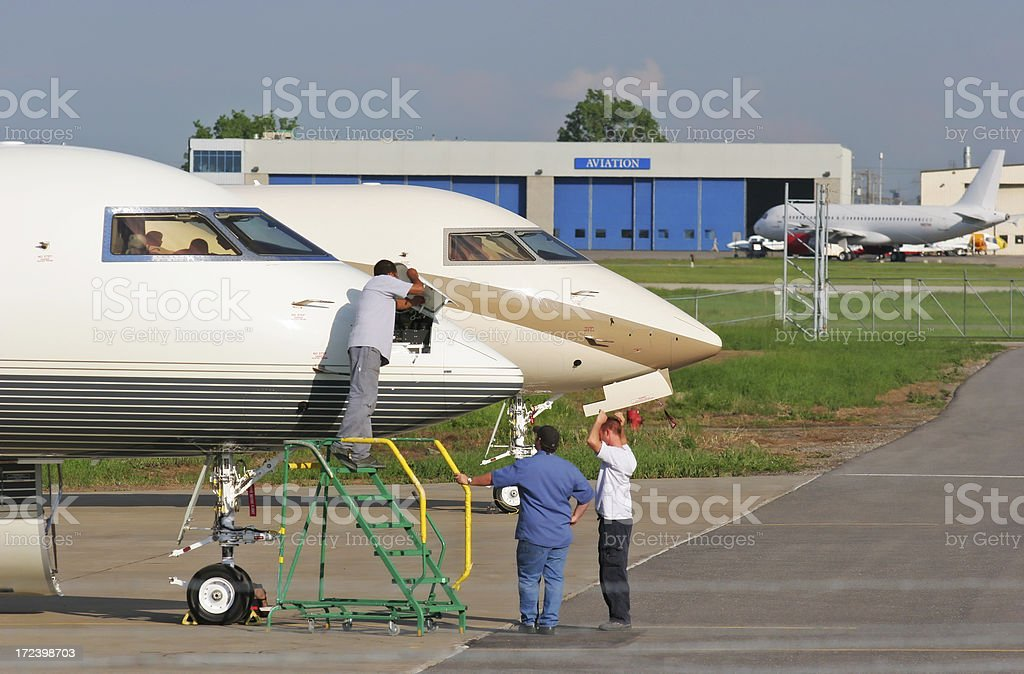 Maintenance people working on Airplanes in Montreal airport royalty-free stock photo