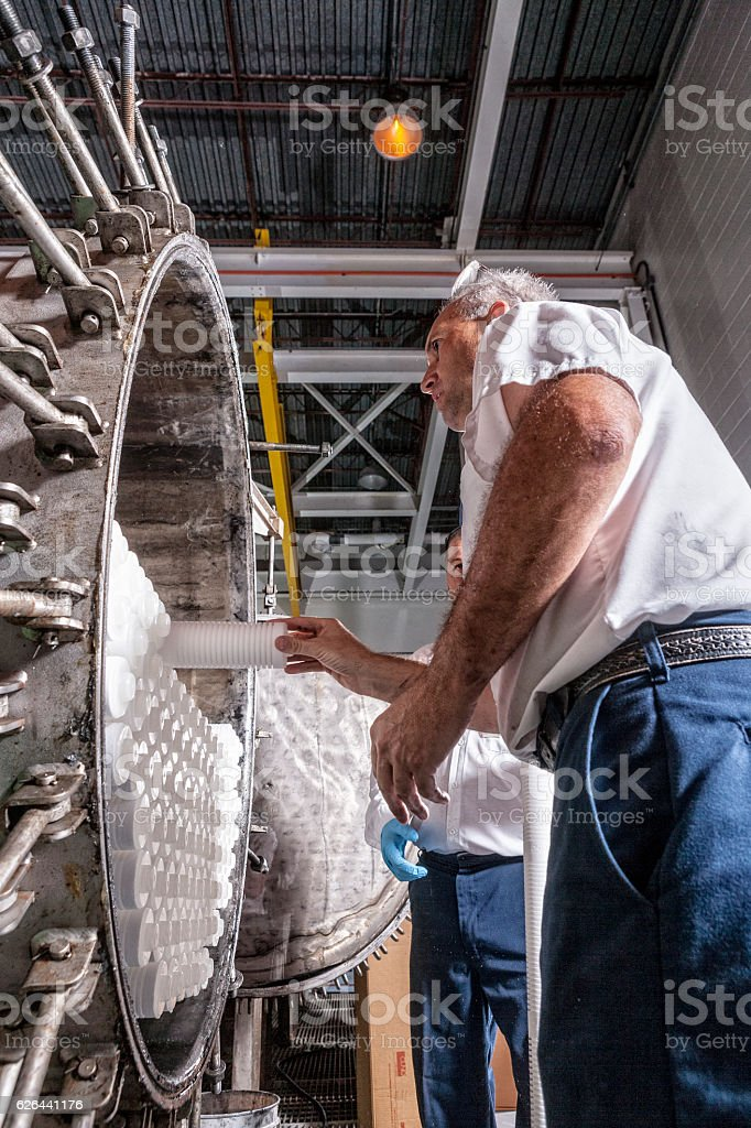 Maintenance Technician Adding New Water Filters at Filtration System stock photo