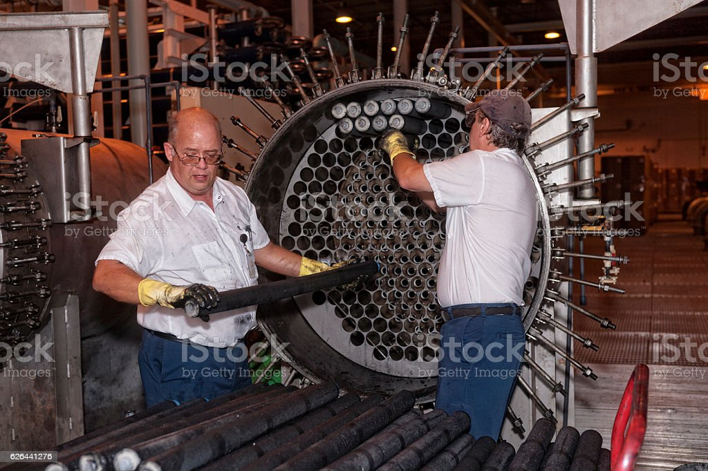 Maintenance Technician Removing Old Water Filters at Filtration System stock photo