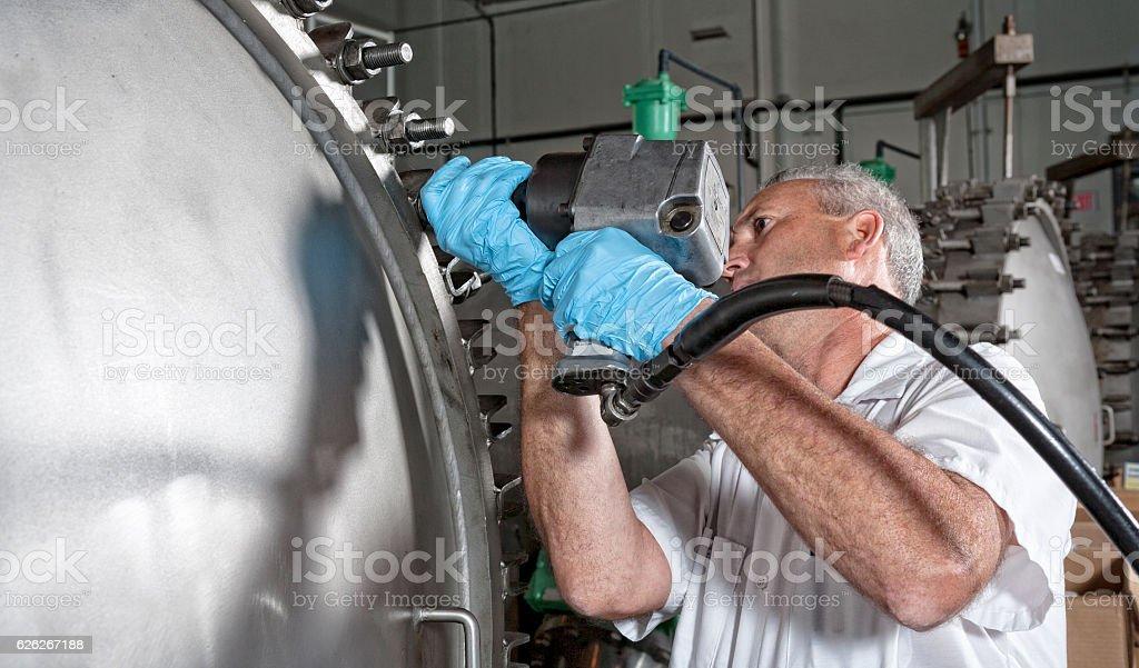 Maintenance Technician Sealing Water Filtration System stock photo
