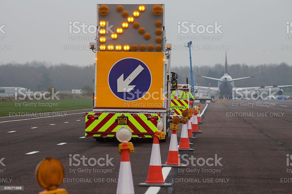 Maintenance Trucks on a Runway stock photo
