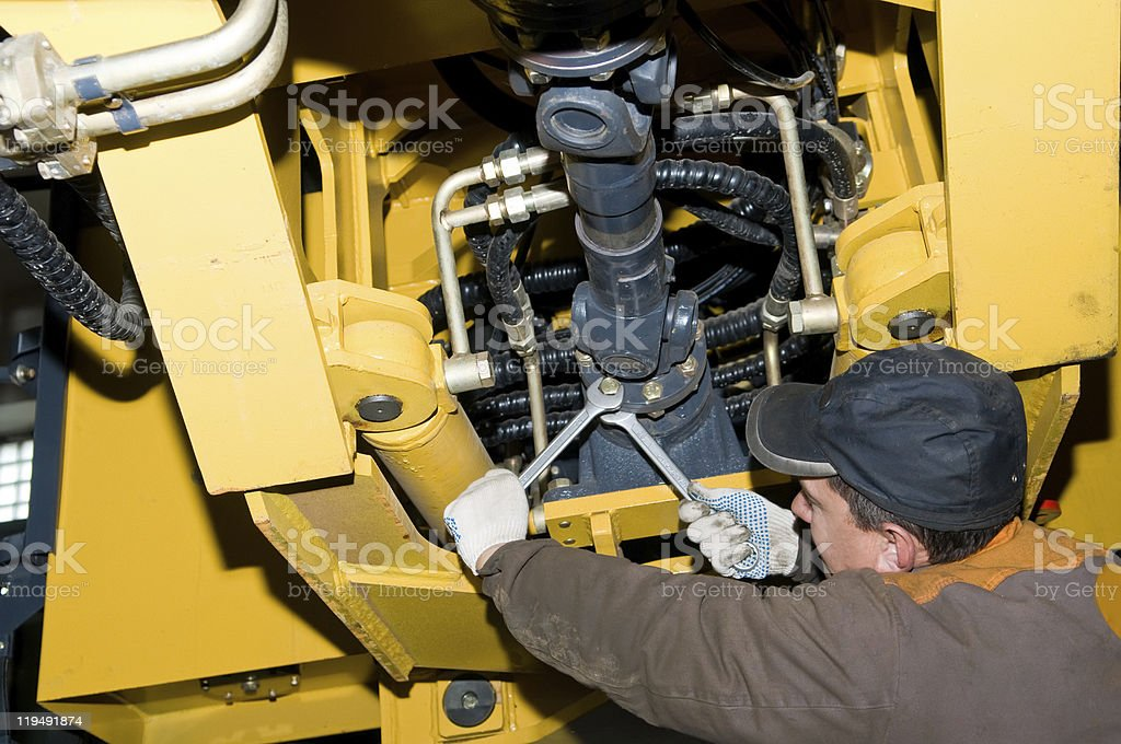 maintenance work of heavy loader stock photo