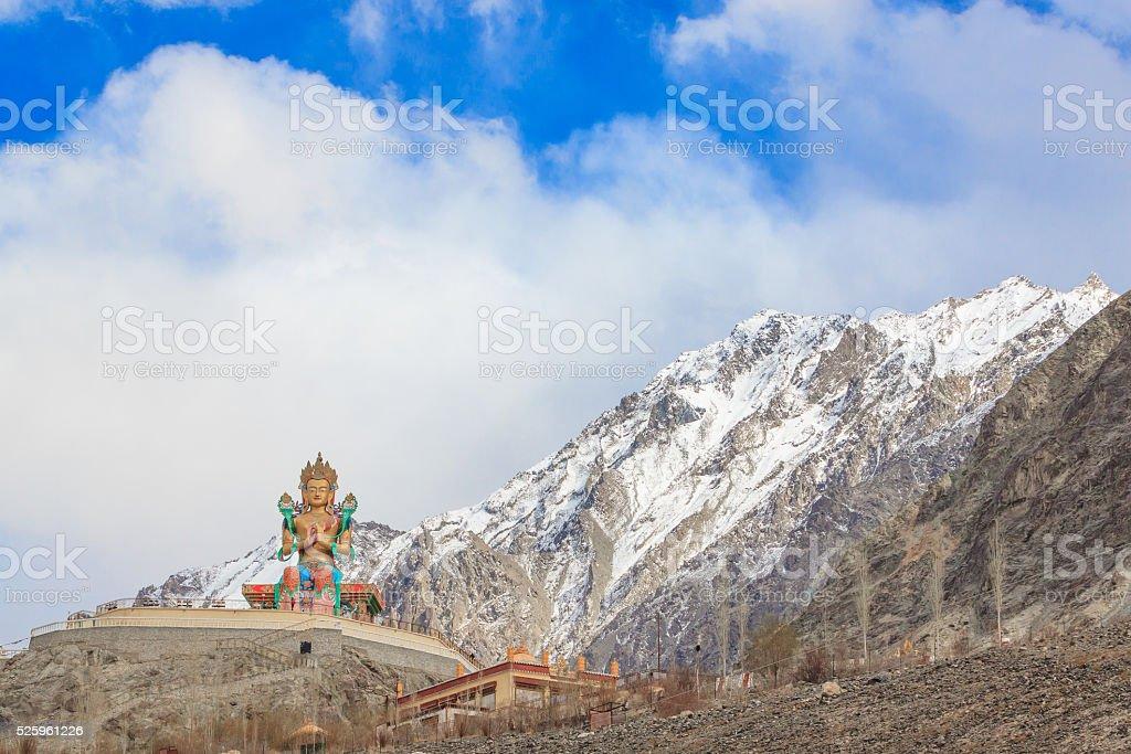 Maitreya Buddha and Diskit Gompa in India stock photo