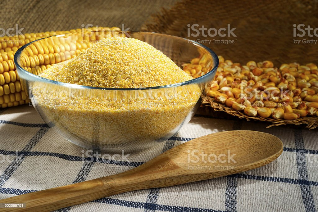 Maize and cornmeal in glass bowl stock photo