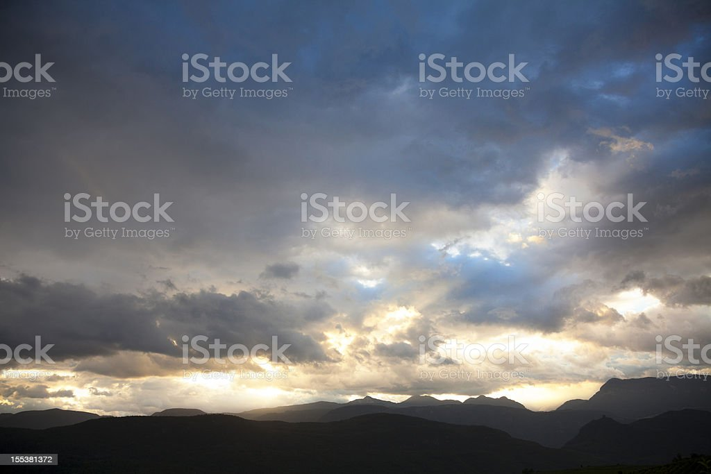 majestic cloudscape over mountain range at sunrise royalty-free stock photo