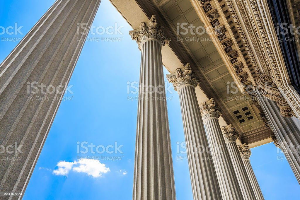 Majestic Columns Frame Blue Sky, Puffy Clouds, Columbia SC stock photo
