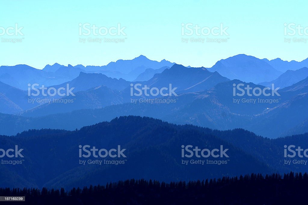 Majestic mountain landscape in various shades of blue royalty-free stock photo